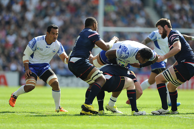 Iosefa Tekori of Samoa is stopped in his tracks during Match 6 of the Rugby World Cup 2015 between Samoa and USA - 20/09/2015 - Brighton Community Stadium, Brighton <br /> Mandatory Credit: Rob Munro/Stewart Communications
