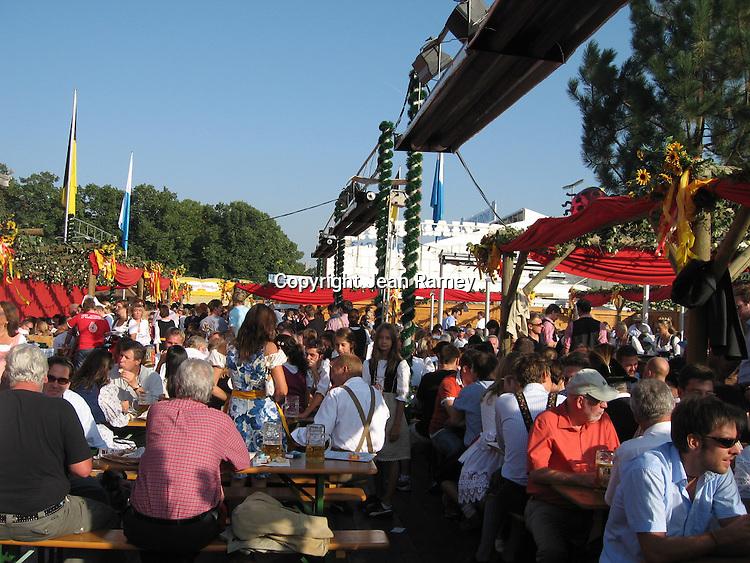 Oktoberfest revelers enjoy a biergarten on a sunny day