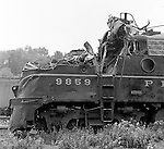 Corliss PA - View of a damaged locomotive at an accident site near the train station at Corliss Pennsylvania.  The assignment was for the PA Railroad due to a train derailment near the station.  Brady Stewart Studio was a contract photography studio for the railroad from 1955 through 1965.