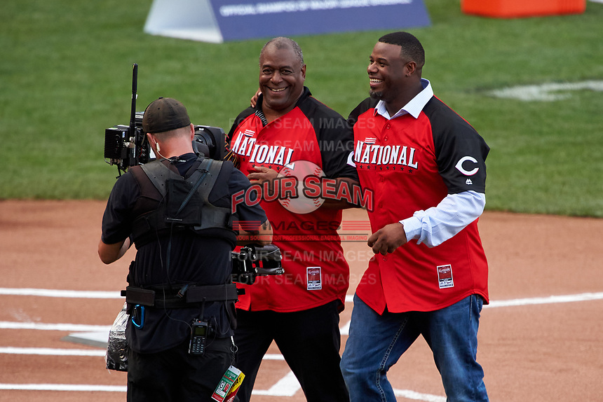 Ken Griffey and Ken Griffey Jr. walk off the field after the ceremonial first pitch during the MLB Home Run Derby on July 13, 2015 at Great American Ball Park in Cincinnati, Ohio.  (Mike Janes/Four Seam Images)