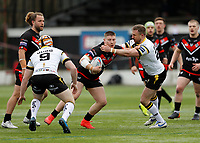 28th March 2021; Rosslyn Park, London, England; Betfred Challenge Cup, Rugby League, London Broncos versus York City Knights; Jacob Jones of London Broncos is tackled by Tim Spears of York City Knights