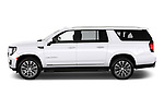 Car Driver side profile view of a 2021 GMC Yukon-XL Denali 5 Door SUV Side View