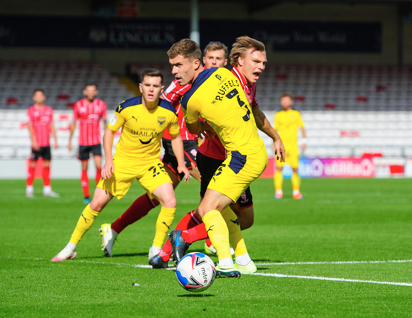 Lincoln City's Harry Anderson vies for possession with Oxford United's Josh Ruffels<br /> <br /> Photographer Chris Vaughan/CameraSport<br /> <br /> The EFL Sky Bet League One - Saturday 12th September 2020 - Lincoln City v Oxford United - LNER Stadium - Lincoln<br /> <br /> World Copyright © 2020 CameraSport. All rights reserved. 43 Linden Ave. Countesthorpe. Leicester. England. LE8 5PG - Tel: +44 (0) 116 277 4147 - admin@camerasport.com - www.camerasport.com - Lincoln City v Oxford United