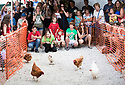 05/08/18<br /> <br /> Competitors race their hens at the Hen Racing World Championship  outside the Barley Mow pub in Bonsall near Matlock Bath, in the Derbyshire Peak District.<br /> All Rights Reserved, F Stop Press Ltd. (0)1335 344240 +44 (0)7765 242650  www.fstoppress.com rod@fstoppress.com