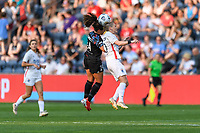 BRIDGEVIEW, IL - JULY 18: Danielle Colaprico #24 of the Chicago Red Stars and Jessica Fishlock #10 of the OL Reign battle for the ball in the air during a game between OL Reign and Chicago Red Stars at SeatGeek Stadium on July 18, 2021 in Bridgeview, Illinois.