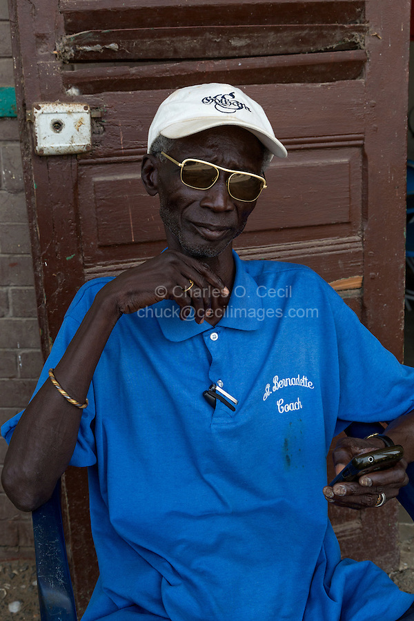 Senegal, Saint Louis.  Caretaker with his Cell Phone at the Abandoned Railway Station, no longer in use.