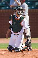 Miami Hurricanes catcher Yasmani Grandal #24 looks to the dugout for a sign against the Florida State Seminoles at the 2010 ACC Baseball Tournament at NewBridge Bank Park May 26, 2010, in Greensboro, North Carolina.  The Hurricanes defeated the Seminoles 9-3.  Photo by Brian Westerholt / Four Seam Images