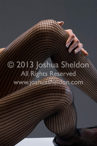 Woman's legs in fish net stockings