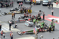 Apr. 15, 2012; Concord, NC, USA: NHRA crew members for top fuel dragster drivers (top to bottom) Tony Schumacher , Doug Kalitta and Terry McMillen during eliminations for the Four Wide Nationals at zMax Dragway. Mandatory Credit: Mark J. Rebilas-