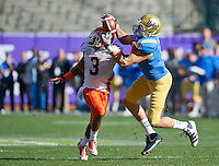 SAN FRANCISCO, CA - December 31, 2011: UCLA tight end Joseph Fauria (8) attempts to catch a pass against University of Illinois cornerback Tavon Wilson (3) at AT&T Park in San Francisco, California. Final score Illinois wins 20-14.