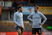 21st April 2021; Kenilworth Road, Luton, Bedfordshire, England; English Football League Championship Football, Luton Town versus Reading; Martin Cranie of Luton Town and Harry Cornick of Luton Town discuss tactics during the warm up.