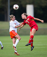 Morgan Brian (6) of Virginia goes up for a header with Sarah Fichtner (2) of Maryland during the game at Klockner Stadium in Charlottesville, VA.  Virginia defeated Maryland, 1-0.