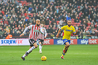 Sheffield United's forward David McGoldrick (17) picks up the ball and runs at Leeds United defence during the Sky Bet Championship match between Sheff United and Leeds United at Bramall Lane, Sheffield, England on 1 December 2018. Photo by Stephen Buckley / PRiME Media Images.