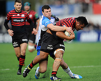 Mako Vunipola of Saracens is tackled by Robbie Henshaw of Connacht Rugbyduring the Heineken Cup Round 6 match between Saracens and Connacht Rugby at Allianz Park on Saturday 18th January 2014 (Photo by Rob Munro)