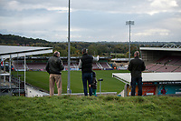 10th October 2020; Sixfields Stadium, Northampton, East Midlands, England; English Football League One, Northampton Town versus Peterborough United; Football supporters try to catch a glimpse of the action from the hill outside Sixfields stadium.