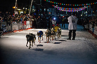 Mitch Seavey drives his team down Front Street in Nome first and winning his second Iditarod seld dog race on Tuesday March 12, 2013. Seavey made the journey from Willow in 9 days, 7 hours, 39 minutes, 56 seconds. ..Iditarod Sled Dog Race 2013..Photo by Jeff Schultz copyright 2013 DO NOT REPRODUCE WITHOUT PERMISSION
