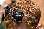 May 4, 2008. Marion, NC.. Just 2 days before the North Carolina primary, former president Bill Clinton campaigned across rural western North Carolina, stumping for his wife. Senator Hillary Clinton, in her drive for rural and working class votes.. A reflection of the crowd in the sunglasses of a reporter.