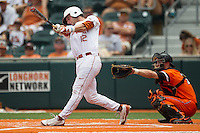 Texas Longhorns designated hitter Jacob Felts #12 swings the bat during the NCAA baseball game against the Oklahoma State Cowboys on April 26, 2014 at UFCU Disch–Falk Field in Austin, Texas. The Cowboys defeated the Longhorns 2-1. (Andrew Woolley/Four Seam Images)