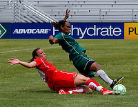 Washington Freedom forward Abby Wambach (20)  tackles the ball away from St. Louis Athletica defender Kia McNeill (6) during a WPS match at Anheuser-Busch Soccer Park, in Fenton, MO, June 20 2009. Washington  won the match 1-0.