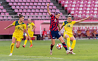 KASHIMA, JAPAN - AUGUST 5: Megan Rapinoe #15 of the USWNT fights for the ball in the box with Alanna Kennedy #14 of Australia during a game between Australia and USWNT at Kashima Soccer Stadium on August 5, 2021 in Kashima, Japan.