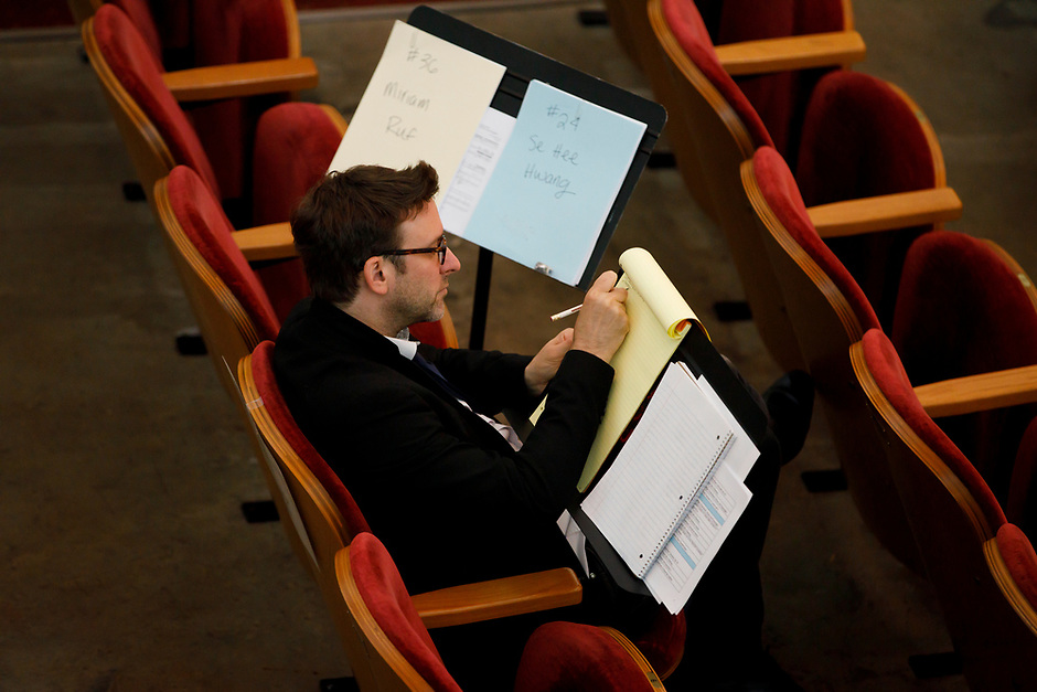 Jury member Sylvain Blassel makes notes during Stage III at the 11th USA International Harp Competition at Indiana University in Bloomington, Indiana on Wednesday, July 10, 2019. (Photo by James Brosher)
