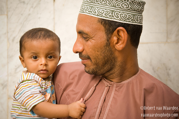 A father and sone at the Mutrah Souq in Oman - National Geographic Traveler