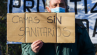 "MADRID, SPAIN - DECEMBER 01: A group of people demonstrate against the opening of the new Isabel Zendal hospital on 01 December 2020, in Madrid, Spain. In the Valdebebas area, under protests from health workers, the new pandemic hospital for the community of Madrid has been inaugurated, created under the name of ""Hospital Isabel Zendal"" in order to help fight COVID-19 , it has 1000 beds and 50 UCIS. The hospital has cost around 100 million euros, having an extra cost of about 50 million euros on the initial budget, in addition to being involved in many controversies due to the fact of having to create a new hospital when several hospitals in the city itself have part of its inactive facilities. (Photo by Joan Amengual / VIEWpress via Getty Images)."