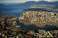 aerial view of city looking north with False Creek and Granville Island in the foreground. City Center, downtown, mountains, Granville Bridge, Burrard Bridge. Vancouver British Columbia Canada.