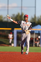 Richard Amion (1) of the Salem-Keizer Volcanoes makes a throw during a game against the Hillsboro Hops at Ron Tonkin Field on July 27, 2015 in Hillsboro, Oregon. Hillsboro defeated Salem-Keizer, 9-2. (Larry Goren/Four Seam Images)