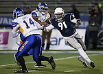 Nevada's Jake Peppard chases San Jose State quarterback Blake Jurich in an NCAA college football game in Reno, Nev., on Saturday, Nov. 16, 2013. (AP Photo/Cathleen Allison)
