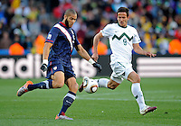 Oguchi Onyewu (left) of USA and Zlatan Ljubijankic (9) of Slovenia. USA vs Slovenia in the 2010 FIFA World Cup at Ellis Park in Johannesburg, South Africa on June 18th, 2010.