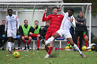 George Sykes of Aveley and Erijo Okosieme of Romford during Romford vs Aveley, Pitching In Ishmian League North Division Football at Mayesbrook Park on 26th September 2020