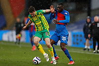 10/13th March 2021; Selhurst Park, London, England; English Premier League Football, Crystal Palace versus West Bromwich Albion; Christian Benteke of Crystal Palace is held off by Dara O'Shea of West Bromwich Albion