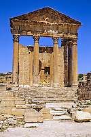 Tunisia, Dougga.  Roman Ruins.  The Capitol.  166 A.D.  The rear wall shows the construction style known as opus africanus, in which large vertical stones are used to strengthen walls built of much smaller stones.