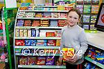 Ellen Hogan enjoying her sweets in David Powers GALA shop in Abbeydorney