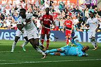 Tammy Abraham of Swansea City (L) scores the equaliser, Heurelho Gomes of Watford (R) lies on the ground helpless during the Premier League match between Swansea City and Watford at The Liberty Stadium, Swansea, Wales, UK. Saturday 23 September 2017