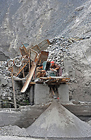 Slag from a mercury mine is graded in the mountains about 30 kilometers from Tongren city, Guizhou, China.