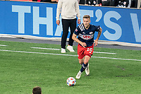 FOXBOROUGH, MA - MAY 22: Arnor Traustason #25 of New England Revolution brings the ball forward during a game between New York Red Bulls and New England Revolution at Gillette Stadium on May 22, 2021 in Foxborough, Massachusetts.