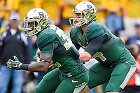 Baylor quarterback Bryce Petty (14) fakes handoff to running back Shock Linwood (32) during an NCAA football game, Saturday, October 11, 2014 in Waco, Tex. Baylor defeated TCU 61-58 to remain undefeated in BIG 12 conference. (Mo Khursheed/TFV Media via AP Images)