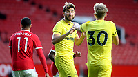 Charlie Goode of Brentford discusses tactics with No 30, Mads Roerslev during Manchester United vs Brentford, Friendly Match Football at Old Trafford on 28th July 2021