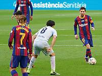 19th December 2020; Camp Nou, Barcelona, Catalonia, Spain; La Liga Football, Barcelona versus Valencia;  Leo Messi of Barca takes on Sole of Valencia on the top of the box