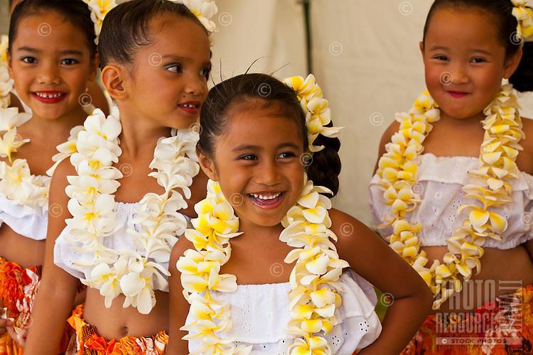 Four girls in plumeria flower leis at the Kauai Polynesian Festival