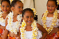 Four girls in plumeria flower leis at the Kauai Polynesian Festival