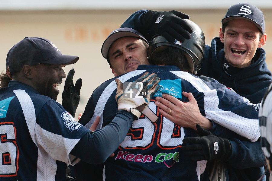 24 October 2010: Tim Stewart of Savigny is congratulated by Boubakar Guaye, Jerome Dussart, Nicholas Waltersperger, after his solo home run during Savigny 8-7 win (in 12 innings) over Rouen, during game 3 of the French championship finals, in Rouen, France.