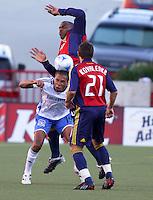 Jamison Olave, Ryan Johnson and Dema Kovalenko in the 0-0 draw at Rice Eccles Stadium in Salt Lake City, Utah on June 18, 2008.