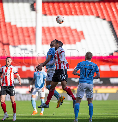 31st October 2020; Bramall Lane, Sheffield, Yorkshire, England; English Premier League Football, Sheffield United versus Manchester City; Riyad Mahrez of Manchester City and Max Lowe of Sheffield United challenge for a header