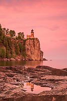 """""""Sunset Reflection at Split Rock Lighthouse""""<br /> <br /> On a beautiful, calm evening, we explored Lake Superior's shoreline in search of treasures around Split Rock Lighthouse. The experience was rich, standing beneath the blushing skies and listening to the accompaniment of frogs and gently lapping waves."""