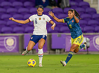 ORLANDO, FL - JANUARY 18: Lynn Williams #6 of the USWNT dribbles away from Caralina Usme #11 of Colombia during a game between Colombia and USWNT at Exploria Stadium on January 18, 2021 in Orlando, Florida.