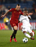 Football Soccer: UEFA Champions League AS Roma vs Qarabag FK Stadio Olimpico Rome, Italy, December 5, 2017. <br /> Roma's Radja Nainggolan (l) in action with Qarabag's Donald Guerrier (r) during the Uefa Champions League football soccer match between AS Roma and Qarabag FK at at Rome's Olympic stadium, December 05, 2017.<br /> UPDATE IMAGES PRESS/Isabella Bonotto