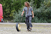 Pictured: A man plays with a spare tyre. Monday 31 August 2020<br /> Re: Around 70 South Wales Police officers executed a dispersal order at the site of an illegal rave party, where they confiscated sound gear used by the organisers in woods near the village of Banwen, in south Wales, UK.